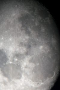 On Thursday, Feb. 22, students had the opportunity to view the moon and other stars through two high-powered telescopes on campus. The event was put on by Physics Professor Steven Harfenist. Harfenist had the telescope set up between the Science Center and the Media Arts Center. On the telescope there was an attatchment for students to hold their cell phones up to the viewfinder to take close-up images of the moon, as shown in the picture above. - Ethan Platt / Senior Multimedia staff
